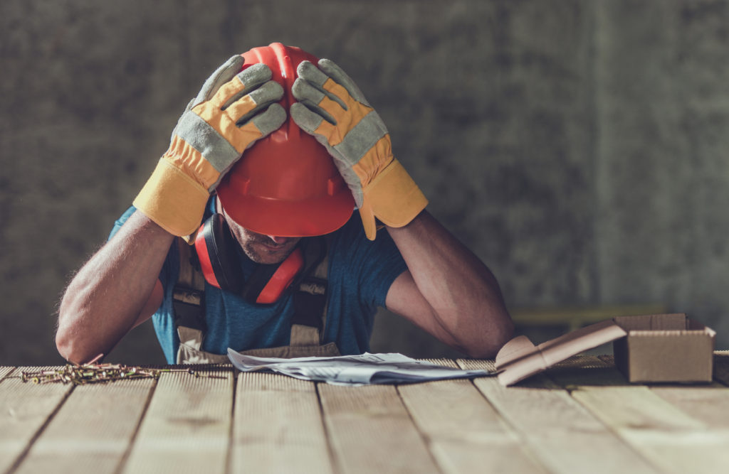 Disappointed Sad Caucasian Contractor Worker Facing Legal Problems. Bond, Insurance, Work Injury Concept Photo.